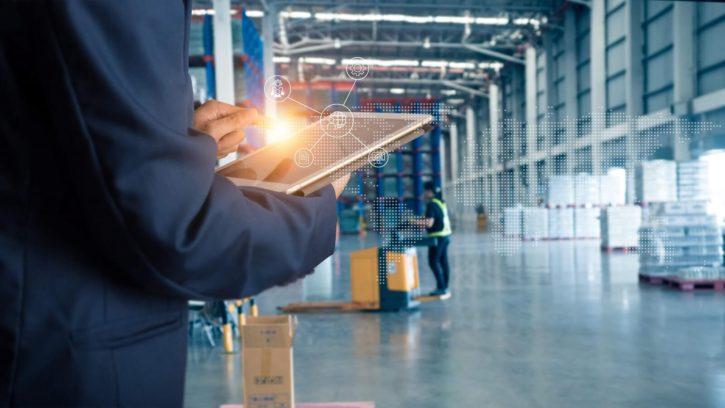 Man using tablet at warehouse shipping dock